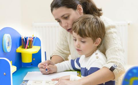 Female teacher with young learner