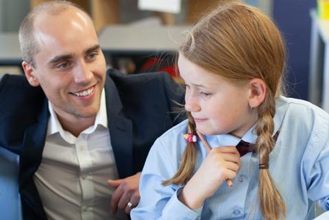 Teacher teaching student.