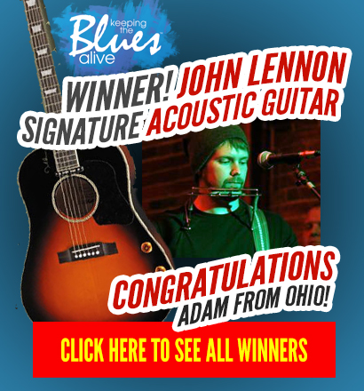 Winner! Congratulations Adam from Ohio! You won a John Lennon signature acoustic guitar courtesy of Keeping the Blues Alive. Click here to see all the winners.