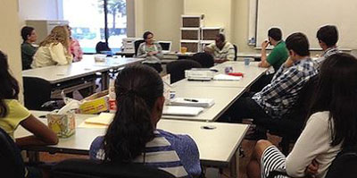 Maurice Caldwell speaking to students, interns and volunteers
