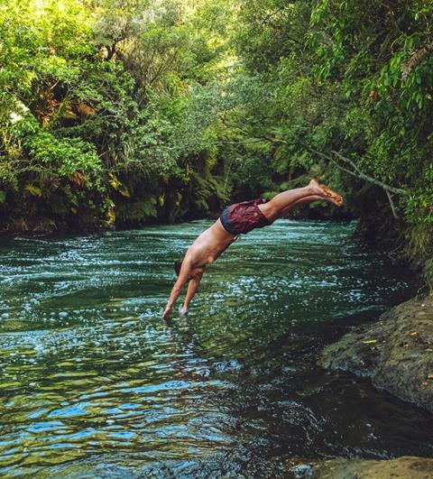 Photo of person diving into river