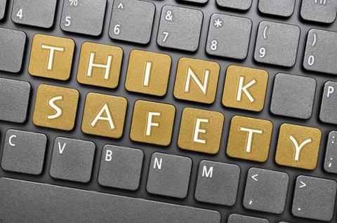 Think safety on keyboard in gold coloured keys