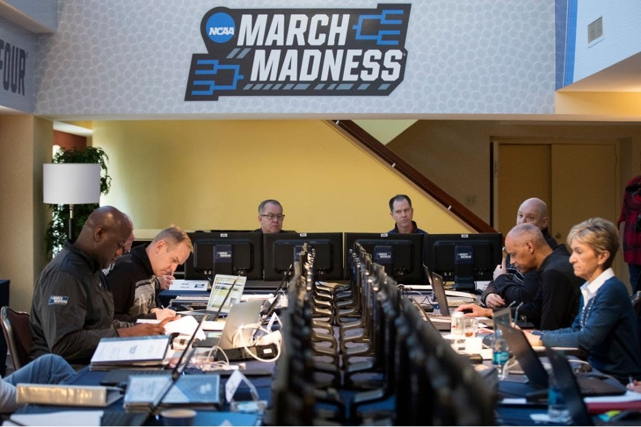 March Madness committee members sitting at conference table